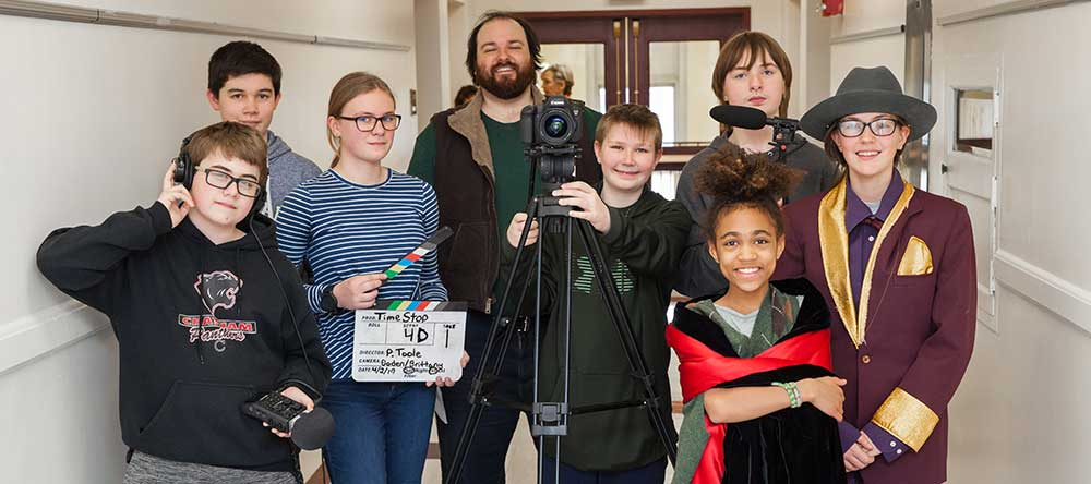 Chatham Middle School students with mentor Patrick Toole. From left to right: Brandon Gearing, Ethan Halpin, Samantha Hoffman, Patrick Toole, Boden Paladino, Iris Davis, Jonah Howard, Izzy Spencer. Teacher liaisons (not shown) are Celia Hetterich and Michele Debye-Saxinger.