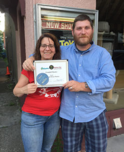 Shari Paylover and Matt Converse, Concessions Staff and Theatre Manager, show off their pleasure at receiving the Best of Columbia County Award for Best Local Movie Theatre